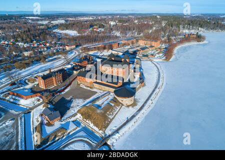 View from the height to the ancient fortress of Hameenlinna by the March sunny day (aerial photography). Finland - Stock Photo
