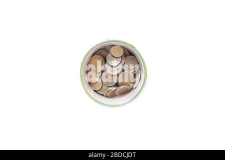 Top view of Turkish Lira (TRY) coins in a jar on isolated on white background. Money growth and deposit accumulation concept. - Stock Photo