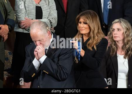 First Lady Melania Trump presents the Presidential Medal of Freedom to gallery guest Rush Limbaugh during President Donald J. Trump's State of the Union address Tuesday, Feb. 4, 2020, in the House chamber at the U.S. Capitol in Washington, D.C. - Stock Photo