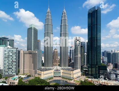 Petronas Twin Towers and downtown skyline with KLCC Park in the foreground, Kuala Lumpur, Malaysia - Stock Photo