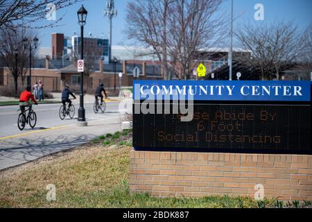 East Grand Rapids, Michigan, April 8, 2020: A community center sign encourages the public to abide by the 6-foot social distancing rule. - Stock Photo