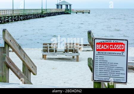 Closed Signs Are Posted On Biloxi Beach During The Covid 19