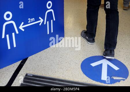 London, UK. 8th Apr, 2020. Photo taken on April 8, 2020 shows signs at a Tesco's store to encourage social distancing in London, Britain. As of Wednesday morning, the number of confirmed cases of COVID-19 in Britain hit 60,733, up 5,492 in the past 24 hours, said the Department of Health and Social Care. Credit: Tim Ireland/Xinhua/Alamy Live News - Stock Photo