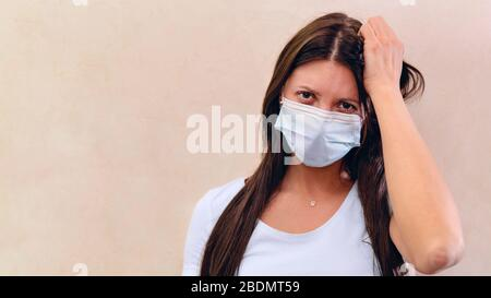 concept suffering from a cold. Portrait beautiful unhappy young woman wearing face mask protects. anti-pollution, anti-smog, and air pollution. with c - Stock Photo