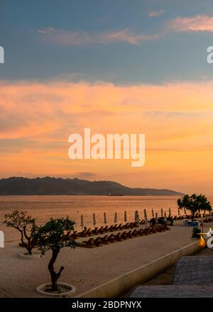 Vertical view across the Lombok Strait from Gili Trawangan to Lombok at sunset, Indonesia. - Stock Photo