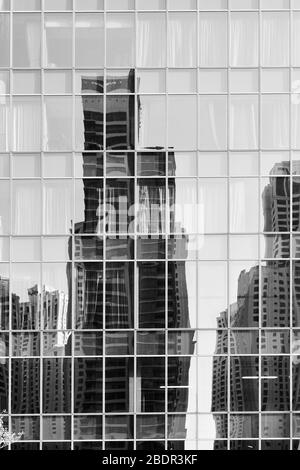 Reflection of towers in the glass wall of a building  -  architectural background - Stock Photo