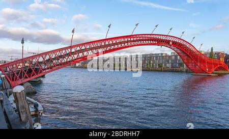 Red Python Bridge at Eastern Docklands in Amsterdam Stock Photo