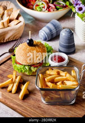 beef burger served with french fries basket - Stock Photo