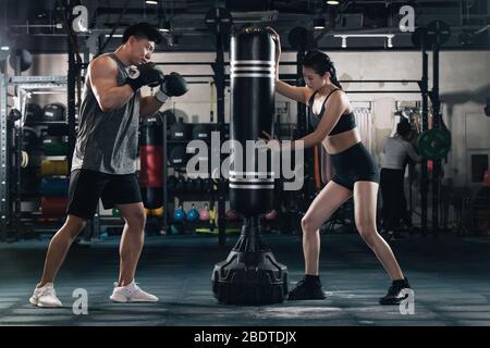 Boxing gym in coaching young man