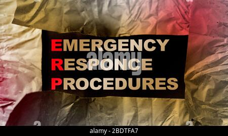ERP as Emergency Response Procedures written under torn paper. Concept image of Business Acronym ERP - Stock Photo