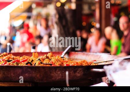 Closeup of Seafood Paella in a large frying pan at Chatuchak weekend market in Bangkok - Thailand - Stock Photo