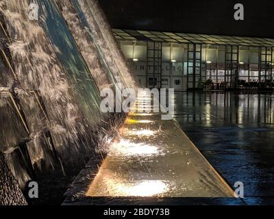 Close up of a water fountain. A colorful spray of water from a fountain. Background and texture - Stock Photo