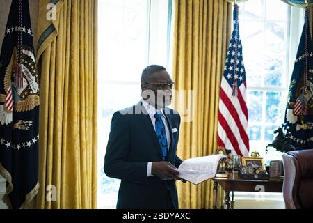 Washington, USA. 10th Apr 2020. Bishop Harry Jackson, senior pastor at Hope Christian Church in Beltsville, Md., offers a Easter blessing to President Donald Trump in the Oval Office of the White House on Friday, April 10, 2020 in Washington, DC Photo by Al Drago/UPI Credit: UPI/Alamy Live News - Stock Photo