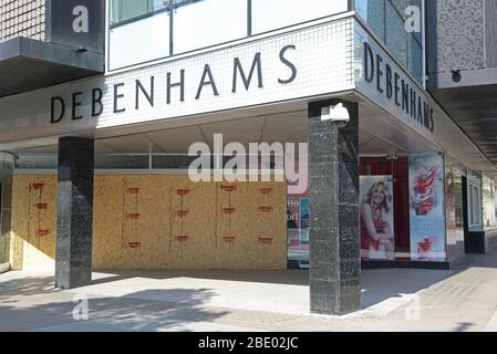 Debenhams goes into administration to stay afloat, during the coronavirus pandemic crisis, here the flagship department store boarded up on Oxford Street, in London's West End, UK