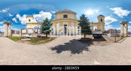 TYKOCIN, POLAND - AUGUST 2019: Full spherical seamless hdri panorama 360 degrees in the yard near old baroque church in equirectangular projection wit - Stock Photo