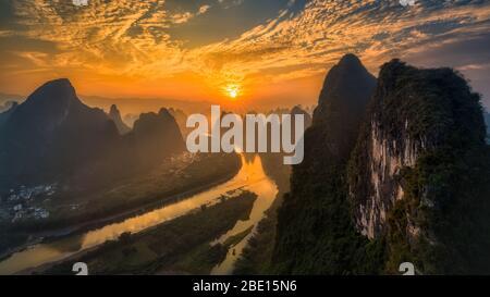 Sunrise landscape of beautiful Li river and limestone hills in Yangshuo, Guilin, China. - Stock Photo