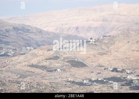 Al Karak fortress in Jordan. The ruins of the castle located on a high slope with a beautiful view. - Stock Photo