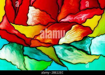 Photo of a small fragment of a beautiful colorful stained glass background including red, yellow, and green pieces. Abstract background..