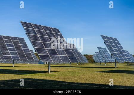 Solar system, overview Solar power plant with trackable elements in sunshine Front view