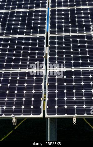 Close-up, detail view of solar panels of a solar power plant in cloudless and bright blue sky - Stock Photo