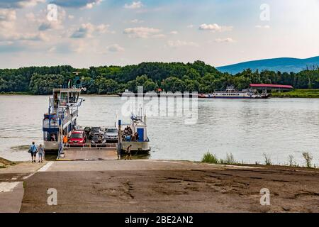 Local ferry transportation across Danube river transporting people from Vac town to Szentendre island.Ferry for people and cars.Hungary,Europe. - Stock Photo