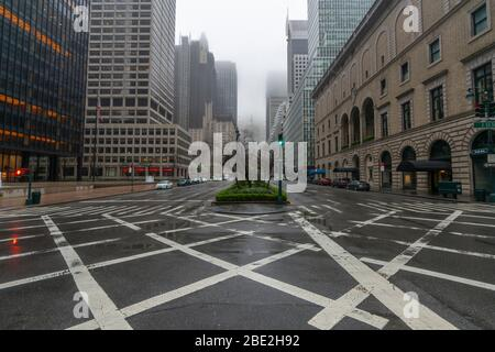 People and traffic disappeared from Midtown Manhattan Park Avenue for impact of COVID-19 in the rainy morning New York City NY USA on Mar. 29 2020. - Stock Photo