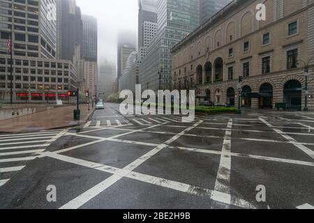 People and traffic disappeared from Midtown Manhattan Park Avenue for impact of COVID-19 in the rainy morning New York City NY USA on Mar. 29 2020.