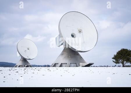 An image of two satellite dishes in Bavaria Germany - Stock Photo
