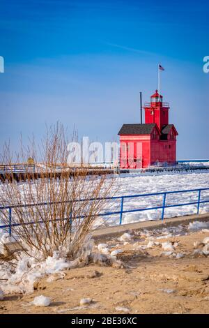 Big Red Holland Lighthouse in winter Stock Photo