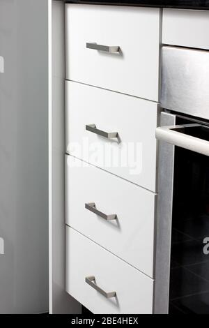 Close Up of Set of Kitchen Cabinet Drawers - Stock Photo