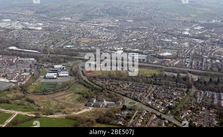 aerial view of Nelson town, Lancashire with Nelson & Colne College prominent near the motorway junction - Stock Photo