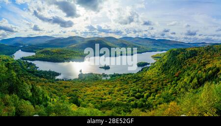 View of La Roche observation point, Monroe Lake and the park, with fall foliage colors in Mont Tremblant National Park, Quebec, Canada Stock Photo