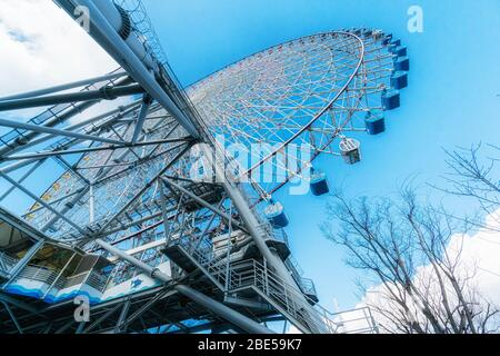 Tempozan giant ferris wheel in Osaka, Japan with  bright blue sky - Stock Photo