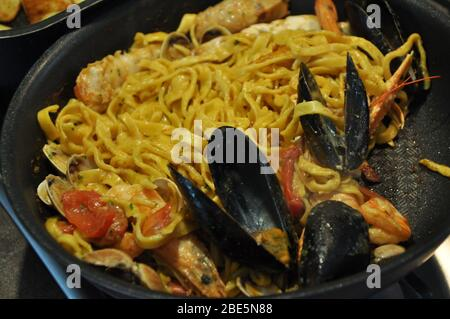 Tagliolini allo scoglio or spaghetti with seafood served i with shrimps and other shells