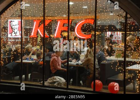 Moscow, RUSSIA - December 19, 2018: Families have dinner at the KFC restaurant in Moscow near the Kremlin.