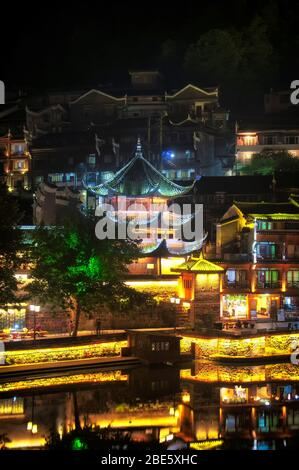 Traditional chinese architecture lit up within Fenghuang Village at night in Hunan province China.