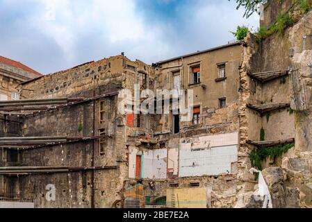 Partially demolished residential apartment building ruins in the streets of historic old town being prepared for restoration in Porto, Portugal