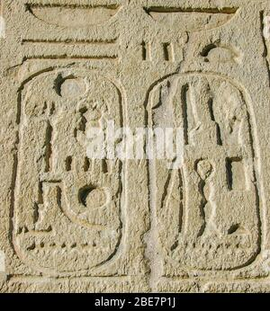 Egypt, Cairo, Heliopolis, open air museum, obelisk parc.  Detail of  a statue of the king Sethy II  : Cartouches of the king on the offering table. - Stock Photo