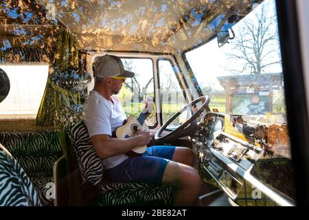 Portrait of careless man during holidays camping in his van