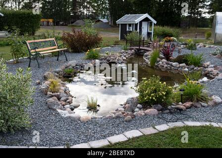 Fish Pond In The North Of Sweden Decorative Landscaping And Water Feature Ideas Stock Photo Alamy