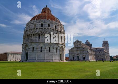 Stunning daily view at the Pisa Baptistery, the Pisa Cathedral and the Tower of Pisa. They are located in the Piazza dei Miracoli Square of Miracles - Stock Photo