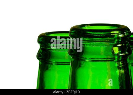 A green beer bottle. Bottleneck in green over a white background. - Stock Photo
