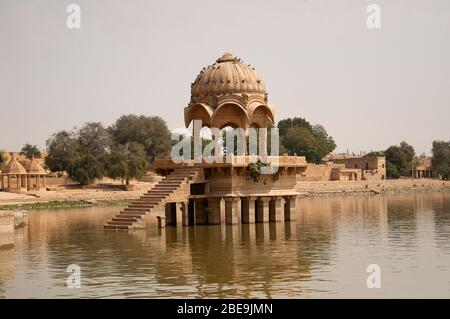 Gadi Sagar temple on Gadisar lake,  Jaisalmer, Rajasthan, India - Stock Photo