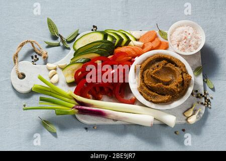 homemade stock in Bouillon cube with fresh vegetables. healthy cuisine - Stock Photo