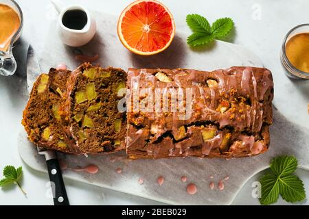 apple homemade vegan loaf cake with icing and espresso coffee. healthy morning breakfast or snack - Stock Photo