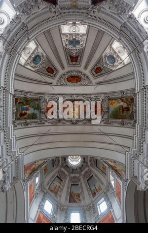 View looking straight up at the stunning ceiling of the main nave and dome inside Salzburg Cathedral (Dom zu Salzburg), Salzburg, Austria. - Stock Photo