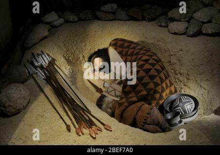 Recreation of a beaker grave. - Stock Photo
