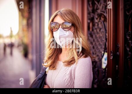 coronavirus, epidemic, covid-19, face, mask, prevention, avoid, touching, do, not, touch, pandemic, protection, businesswoman, woman, mobile, phone, h Stock Photo