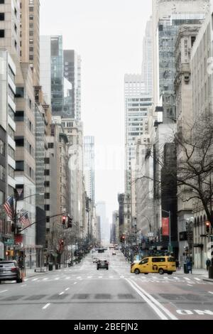 Fifth Avenue in Midtown Manhattan is nearly deserted due to the COVID-19 pandemic, April 2020, New York City, USA