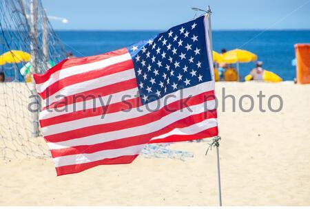 flag of the united states of america outdoors on copacabana beach in Rio de Janeiro Brazil. - Stock Photo